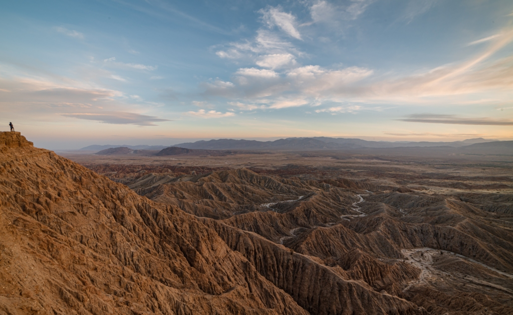 View from Font's Point in Anza Borrego Desert State Park shows exotic hill formations of the badlands in the foreground and a gorgeous sunset skyline in the background